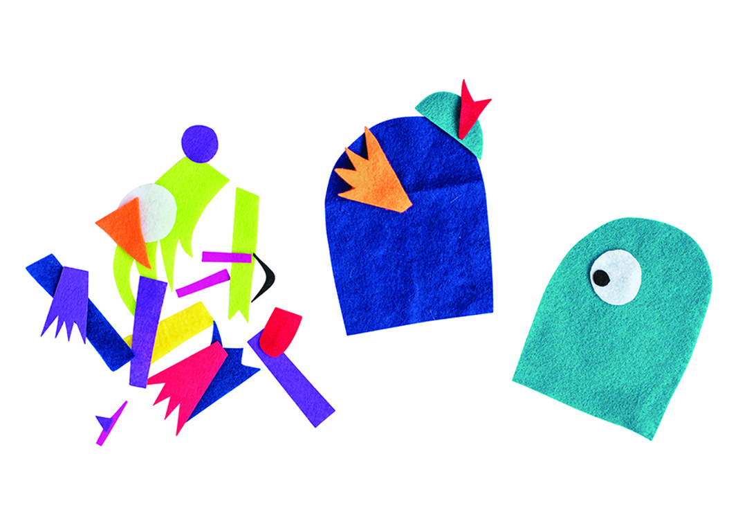 Colorful pieces of cutout felt come together to make alien-like figures.