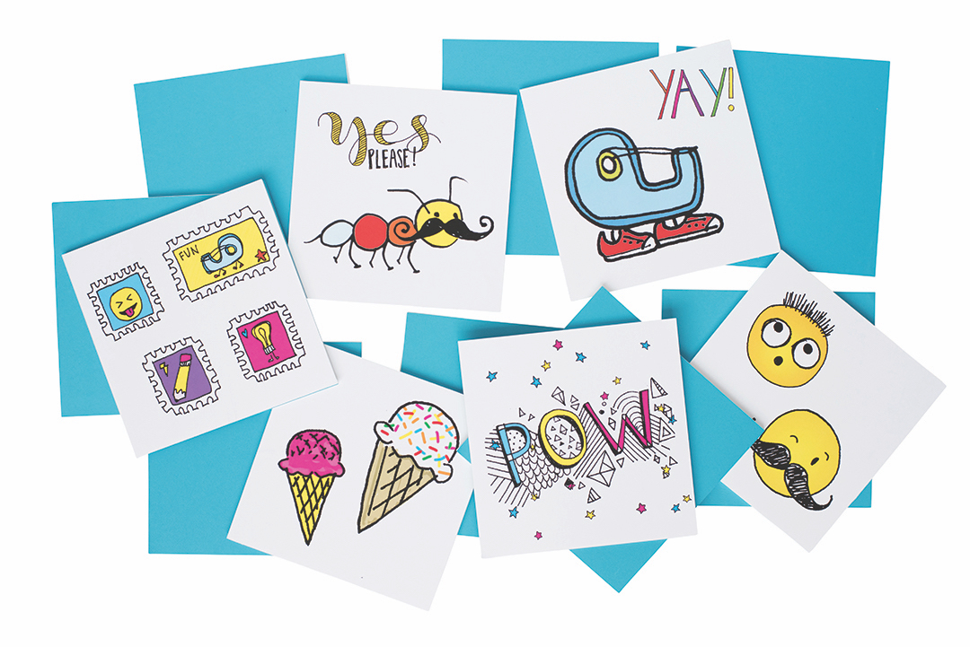 A collection of colorful handmade cards with smiley faces, ice cream cones, and handmade lettering.
